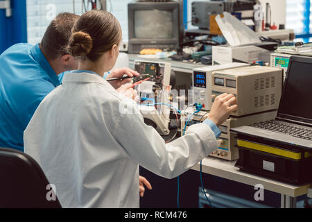 Team of electronic engineers testing a product prototype - Stock Photo