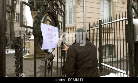 STRASBOURG, FRANCE - MAR 18, 2018: Pooling station text on paper at Russian presidential election 2018 with senior Russian male entering the gate of Consulate General of the Russian Federation to vote for President - Stock Photo