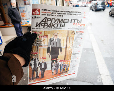 STRASBOURG, FRANCE  - MAR 22, 2018: Argumenty i Fakty russian newspaper with photograph of Vladimir Putin and 76.69 percents of votes gainded at Russian Presidential Elections  - Stock Photo