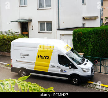 PARIS, FRANCE - SEP 13, 2017: White HERTZ rent a van service seen from above on a French street near a house - Stock Photo