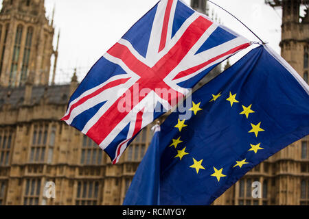 London, UK. 15th January, 2019. European Union and British Union Jack flag flying together. A symbol of the Brexit EU referendum Credit: Ink Drop/Alamy Live News - Stock Photo