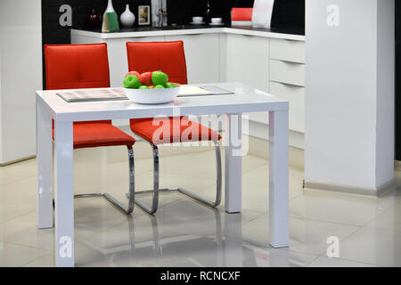 Fragment of white kitchen interior with table - Stock Photo