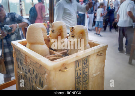 Alabaster canopic jars exhibits, treasures from the tomb of Tutankhamun on display in the Museum of Egyptian Antiquities (Cairo Museum), Cairo, Egypt - Stock Photo