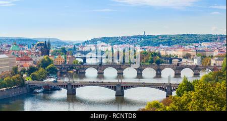 Three bridges over the River Vltava Prague skyline Prague Czech Republic Europe - Stock Photo