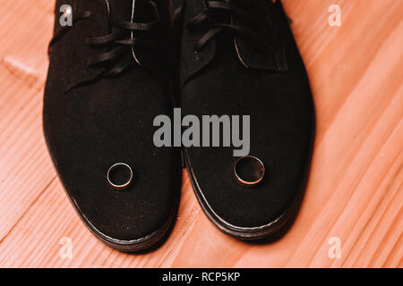 wedding rings and shoes - wedding details of the groom 2019 - Stock Photo