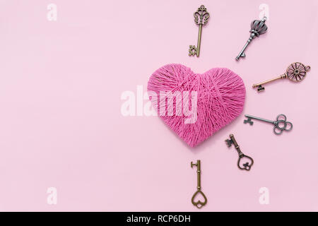 Pink heart with love key. Valentine's Day pink background. Top view.Greeting card.Copy space.old keys with pink heart isolated , sweet pink tone. Hobby concept.Colorful yarn - Stock Photo