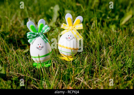 Easter eggs cute bunny on trendy pink background. Funny decoration. Happy Easter Handmade Springtime. Holiday background.Festive concept.Easter bunny decoration.DIY holiday handicraft of colorful rabbits - Stock Photo