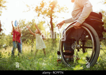 Close-up view on the wheels of a wheelchair. Bright - Stock Photo