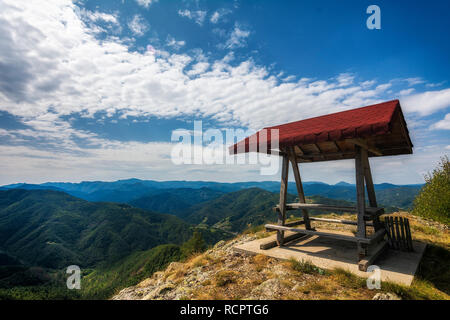 wooden bower with nice mountain view - Stock Photo
