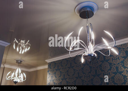 Close-up of a beautiful crystal chandelier Beautiful chandelier. luxury expensive chandelier hanging under ceiling. - Stock Photo