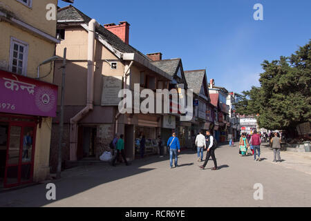 Shimla, N. India.  People walking on main street, 'The Mall'.  Tudor style buildings in background. - Stock Photo