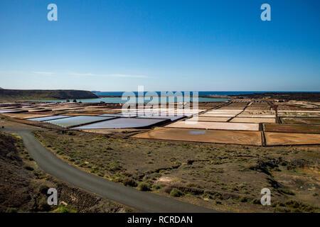 The Salinas de Janubio salt flats in Lanzarote, Canary Islands - Stock Photo