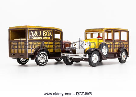 Matchbox Models of Yesteryear Y-21 Ford Model A Woody Wagon 1930. Two versions: yellow bus, and orange van. - Stock Photo