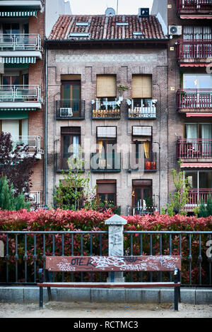 Apartment buildings seen from the botanical garden 'Dalieda of San Francisco' in the neighborhood 'La Latina' of Madrid, Spain. This classical, pictur - Stock Photo