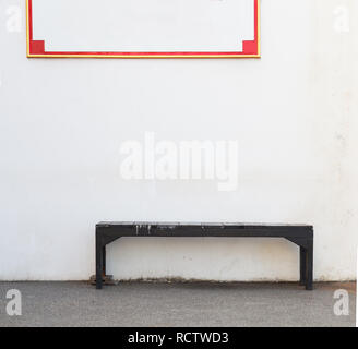 traditional Thai Asian vintage retro wooden bench on white wall and blank signboard background. Rustic Architectural Home Interior, House Furniture De - Stock Photo