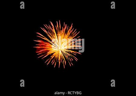 Single exploding firework with black background. - Stock Photo