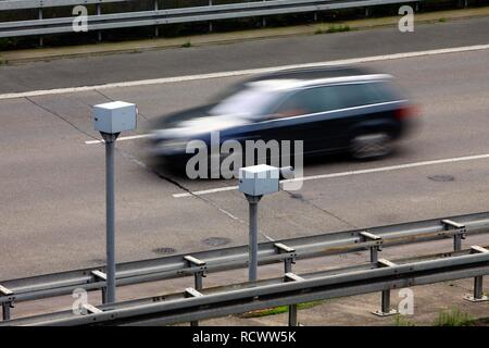 Radar controlled speed monitoring with speed cameras, on the Autobahn A44 motorway, in a 100 kilometers per hour speed-limit - Stock Photo