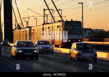 Public transport and private vehicles, tram and cars, on the Rheinkniebruecke Bridge over the Rhine River, Duesseldorf - Stock Photo