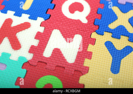 Colored alphabets letters and numbers. - Stock Photo