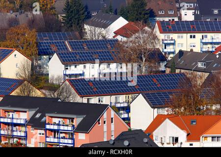 Multi-family houses, photovoltaic systems, solar systems on many roofs of the residential area, Bottrop, North Rhine-Westphalia - Stock Photo