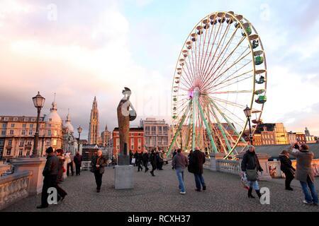 Christmas market, ferris wheel, on the Scheldt or Schelde river bank, historic centre of Antwerp, Flanders, Belgium, Europe - Stock Photo