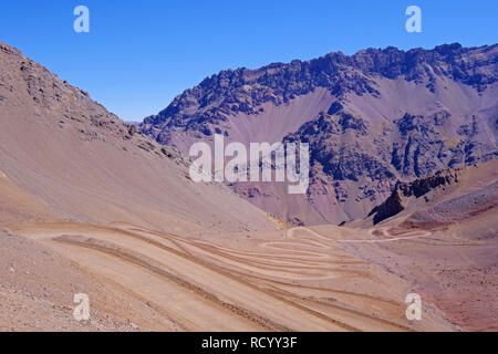 Old dangerous mountain road of the Paso de la Cumbre or Cristo Redentor in the Andes between Argentina and Chile - Stock Photo