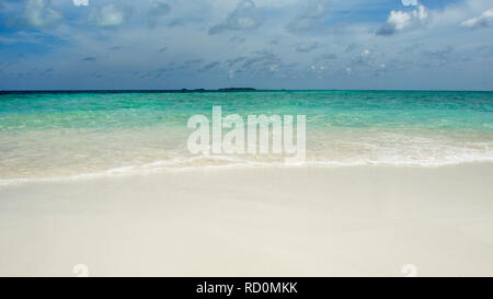 Secluded island. Paradise tropical island, white sand and clear water. Landscape with turquoise surf and beautiful blue sky