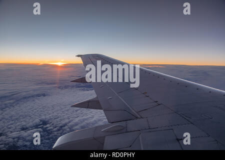 sunset from the windowseat of the airplane - Stock Photo