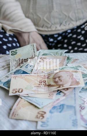 Turkish Lira banknotes on table - Stock Photo