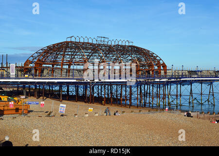 Burnt out shell of Eastbourne Pier following the fire in 2014. Eastbourne seafront, East Sussex, UK - Stock Photo