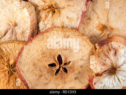 Slices of dried apple as a background. Closeup image - Stock Photo