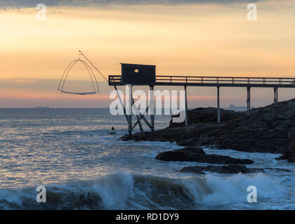 Pier and cabins for fishing in the atlantic ocean near Nantes in France. - Stock Photo