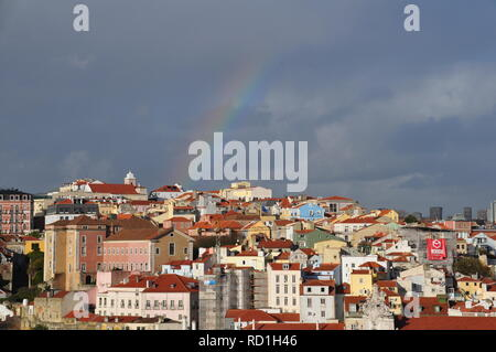 Rainbow over the city of Lisbon - Portugal - Stock Photo