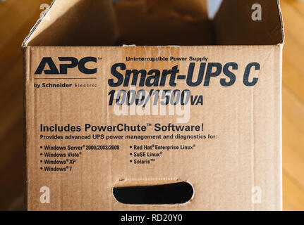 PARIS, FRANCE - MAR 29, 2018: Detail of the open box of APC Smart-UPS C 1000VA LCD 230V enterprise-level uninterruptible power supplies made by American Power Conversion - Stock Photo