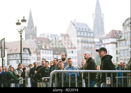 STRASBOURG, FRANCE - SEP, 19 2014: Group of people in line queue front of Apple Store waiting to buy the latest iPhone iPad Apple Watch and MacBook pro laptop and notebook - Stock Photo