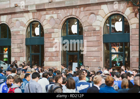 STRASBOURG, FRANCE - SEP, 19 2014: Apple Store facade with customers waiting in line to buy the latest iPhone iPad Apple Watch and notebook - Stock Photo