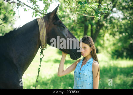 Having the truest friend. Adorable horse owner with her pet. Young woman with horse on summer landscape. Pretty girl at horse ranch. Making friends with horse, friendship and love - Stock Photo