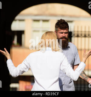I dont understand you. Woman shouting and gesturing at bearded man. Couple in love quarreling on street. Conflict management in couple relationship. Conflict between lovers. Family conflict - Stock Photo