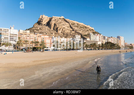 Man using metal detector along the beach in Alicante, Spain, Europe - Stock Photo