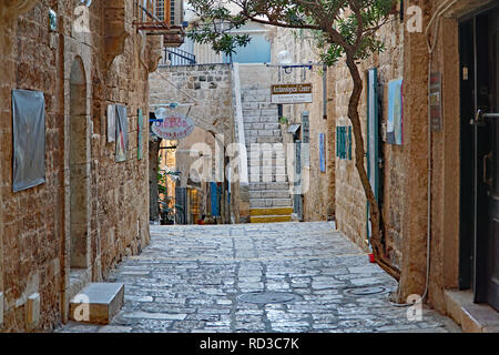 JAFFA, ISRAEL - JANUARY 2017: The narrow cobblestoned lanes of the old town of Jaffa on the Mediterranean features shops dealing in antiquities and ar - Stock Photo
