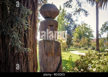 Chemamull wood statue of mapuche culture at Undurraga Vineyard -  Santiago, Chile - Stock Photo