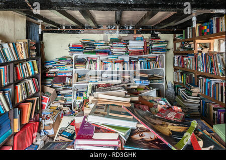 Presteigne, Powys, UK. The cluttered interior of a secondhand bookshop in this small Welsh border town - Stock Photo