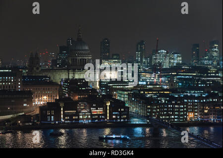 London, UK. Night view across the River Thames from Tate Modern, showing St Paul's Cathedral in the heart of the City, London's financial district - Stock Photo