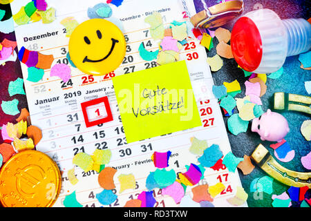 Calendar for 2019 and slip of paper with the label good intentions!, Kalender für das Jahr 2019 und Zettel mit der Aufschrift Gute Vorsätze! - Stock Photo