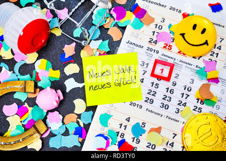 Calendar for 2019 and slip of paper with the label new year, new luck!, Kalender für das Jahr 2019 und Zettel mit der Aufschrift Neues Jahr, neues Glü - Stock Photo