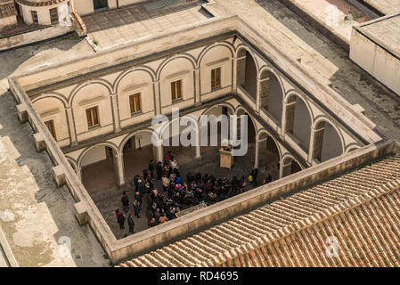 NAPLES, ITALY - JANUARY 7: view of the Certosa di San Martino with visitors grabbed in the court, on January 7, 2018 in Naples, Italy - Stock Photo