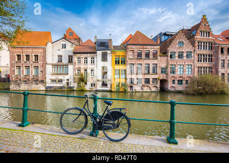 Beautiful view of the historic city of Ghent with traditional colorful buildings and old bicycle, Flanders region, Belgium - Stock Photo