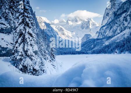 Scenic view of romantic winter wonderland in the Alps with Dachstein glacier in the background, Gosau, Upper Austria region, Austria - Stock Photo