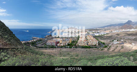 Tenerife - Panorama of Los Cristianos with arriving ferry - Stock Photo