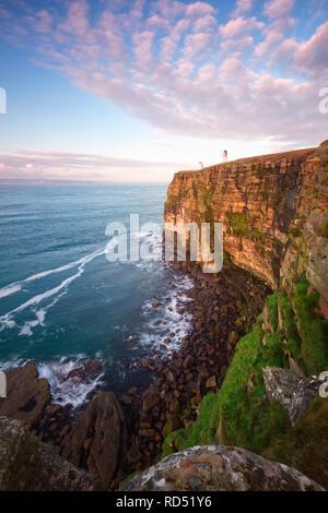 Dunnet Head cliffs and lighthouse, Caithness - Stock Photo